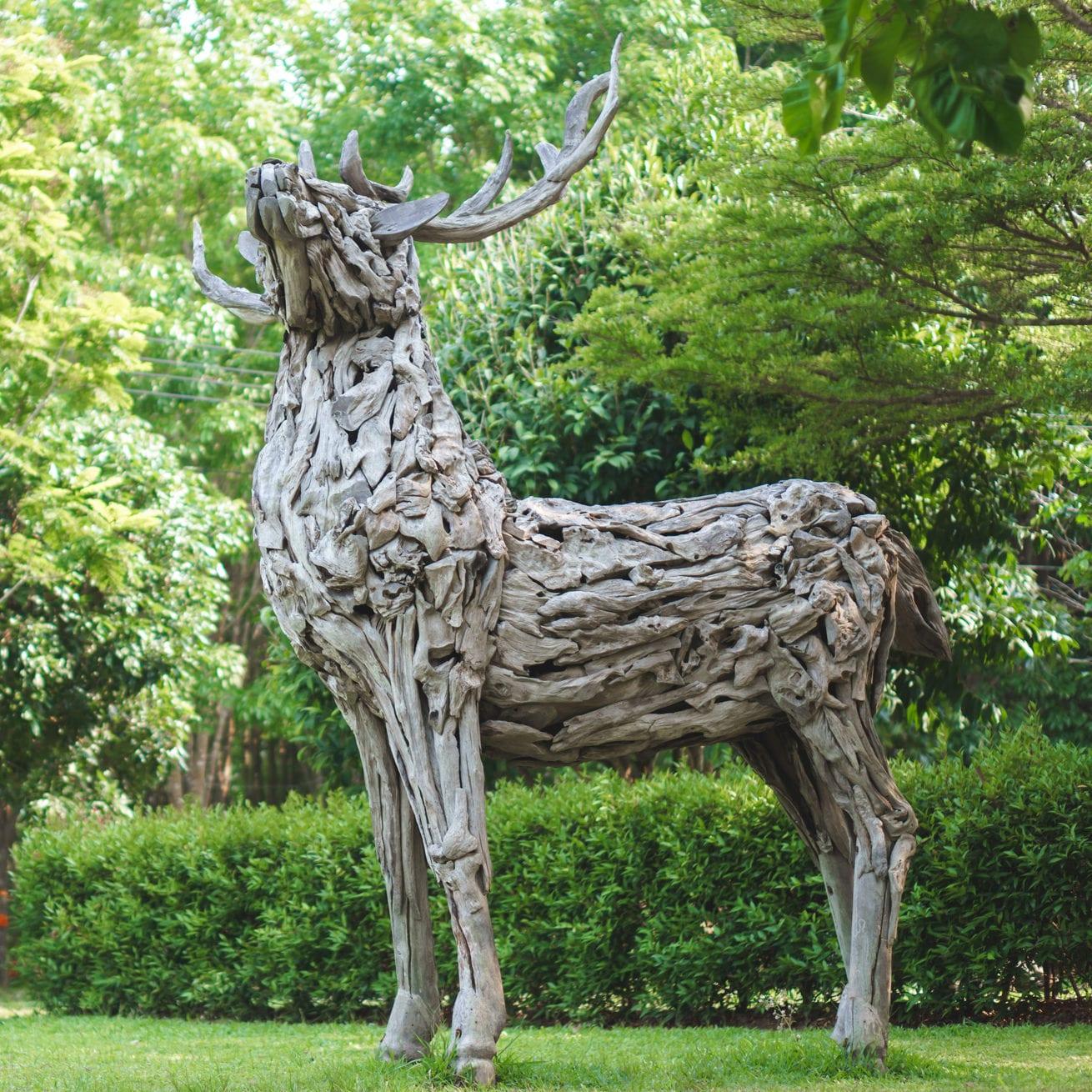 wooden deer statue made of driftwood